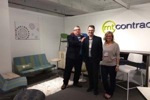 MT Contract's Dan Driessche, Jake Seaver, and Joyce Degen stand in the company's  display at this year's NeoCon expo in Chicago.