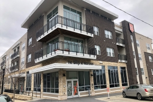 The Brix at Midtown Apartments in Grand Rapids, which recently sold to a New York City real estate and development firm, features amenities including a heated swimming pool, two-story fitness center, lounge and golf simulator.