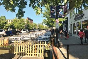 The city blocked off portions of Washington Avenue in downtown Grand Haven to allow bars and restaurants to use the space for additional seating.