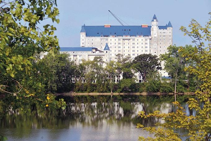 The polarizing Grand Castle apartment complex in Grandville features 522 units and amenities including free parking, a pool and fitness center. The concrete structure's modular construction and scale allowed developers to deliver units at rents in the range of $1-$1.40 per square foot, well below the rates for newer apartments in and around downtown Grand Rapids. Executives at property management firm Land & Co. say they have about 325 people on a waiting list for the property, while about 50 people have put money down on an apartment at the Grand Castle.