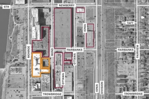 Spectrum Health acquired the Brass Works Building on North Monroe and an adjacent parking lot, shown with the orange border. The building will be incorporated into the health system's scaled-back plans for the Center for Innovation and Transformation. Spectrum has been buying up a series of properties (bordered in red) in the Monroe North neighborhood over the last year.