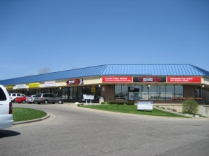 The 91,225-square-foot shopping center, located at 2035 28th St. in Grand Rapids, includes tenants Buffalo Wild Wings, Bluff Banquet, Rent-A-Center and Capital Cities Hobbies.