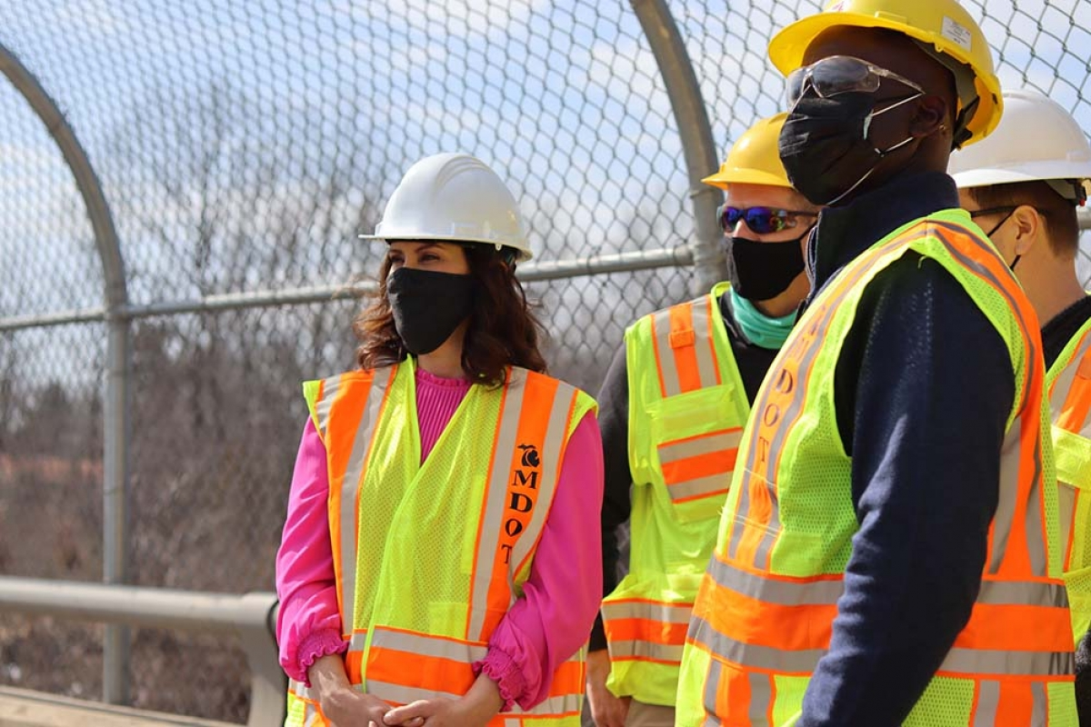 Gov. Gretchen Whitmer surveys an I-94 bridge in Jackson last month that's being repaired under the state's Rebuilding Michigan bonding initiative.