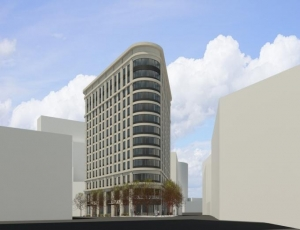 Hinman Co. plans a 13-story development for a triangular lot bordered by Fulton Street, Louis Street and Ionia Avenue in downtown Grand Rapids.