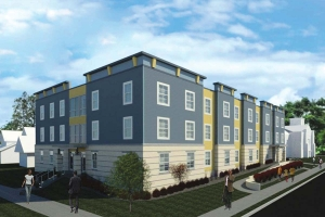The $6.5 million West Garfield development includes 26 residential units at 100 Burton St. SE. The units are available to residents making 30-60 percent of the area median income, and will rent for between $550-$800 per month.